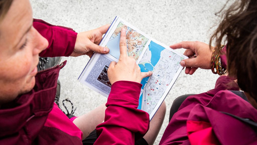 Two women looking at a map
